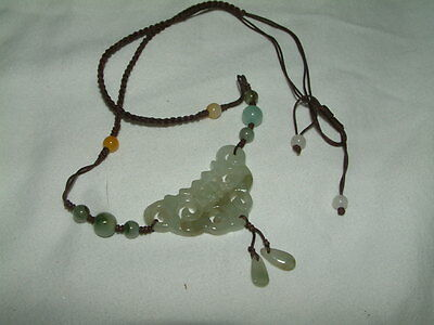 Chinese Carved Celadon Jade openwork pendant, Yellow, white & green beds on cord