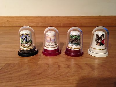 Four Collectible Thimbles In Plastic Domes