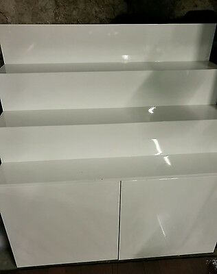 Retail, stock display, storage stand gloss white laminate on casters.