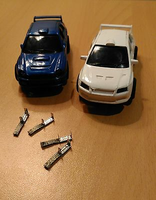 2 slot cars with lights + 2 extra pairs of brushes