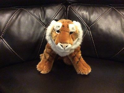 "FAO schwartz plush tiger. new with tags. 28"" nose to end of tail."