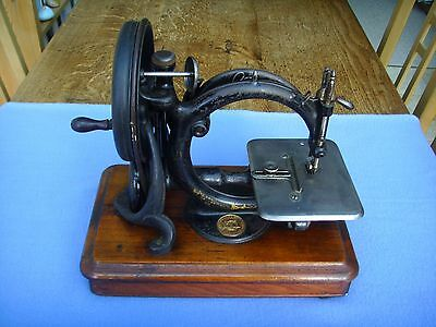 A RARE ANTIQUE SEWING MACHINE, by WILLCOX & GIBB.