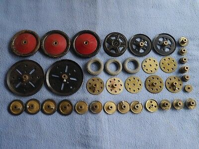 Vintage Meccano. Mixed lot Wheels. gear, tyres etc (all listed)