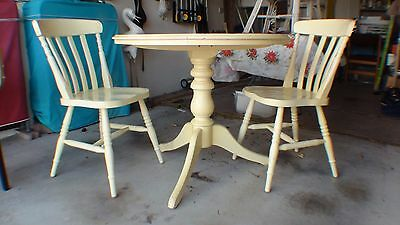 Round Wooden Table and Two Chairs
