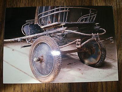 Antique pony cart horse drawn carriage