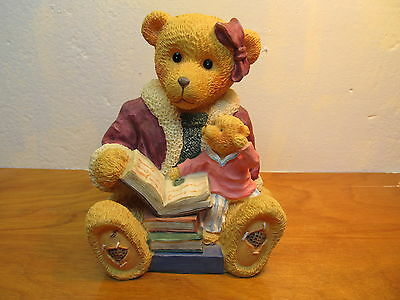 mother bear reading to baby bear bank