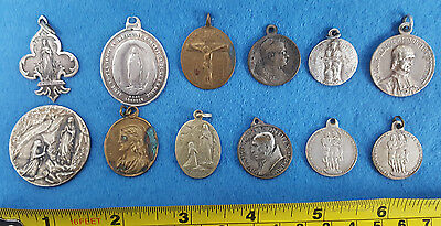 12 x Mainly Religious Medallions. All pre-loved. Sold as seen.  Free P&P to UK