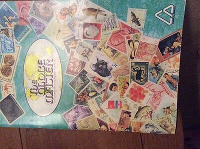 the globe master stamp album with stamps lots of space related stamps