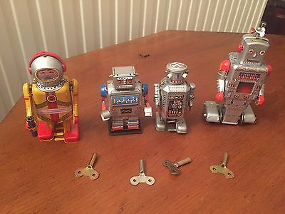 4 Wind Up Tin Plate Robots With Keys