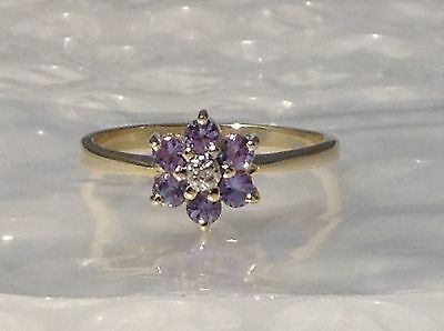 9ct  YELLOW GOLD BLUE TOPAZ AND DIAMOND RING - SIZE N 1/2