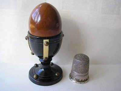 Antique silver thimble in turned wood 'eggcup' box