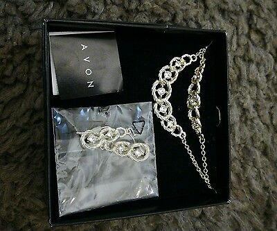 Avon sterling silver necklace and matching earrings