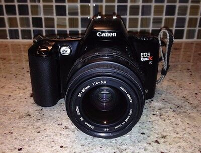 Canon EOS Rebel X S 35mm SLR Film Camera with two lenses