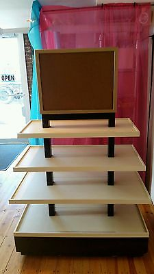 4-Tier Merchandise Display Table Retail Clothing Stand Used/Local Pick-up Only