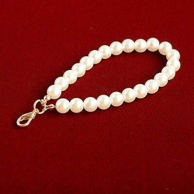 Faux pearl purse handle with gold coloured lobster claw clasp