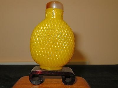 Fine and well carved yellow Peking Glass snuff bottle. Antique! Unusual!