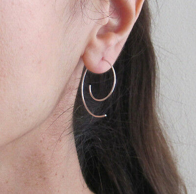 One pair of sterling silver, yellow, rose gold filled wire swirl hoops earrings
