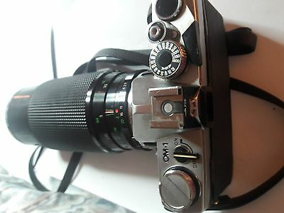 Vintage Olympus OM-1 35 mm Camera with telescopic lens and strap