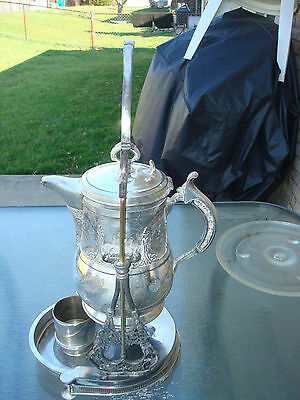 VINTAGE tilting silver plate water pitcher large needs cleaning