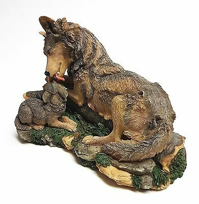 "Avon (Source of Fine Collectibles) Wolf Mother and Pup Figurine ""Tender Moment"""