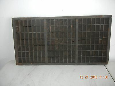 Old printers type tray with 147 equal size spaces.