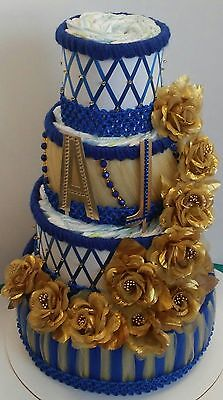 A Royal Prince Themed Baby Boy Shower Decor 4 Tier Blue  and Gold Diaper Cake