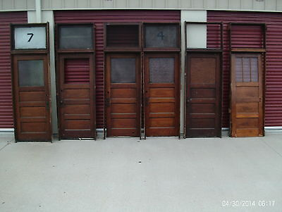 Antique storefront entryway  - 3 panel door set with trim hardware jamb transom