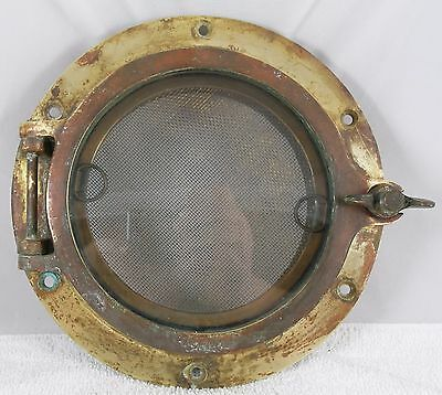 """Antique bronze porthole, salvaged from a William Hand sailboat 6"""" glass 9"""" dia"""