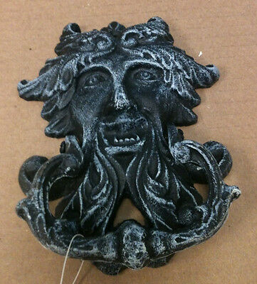 "Cast iron antique black greek god face . Measures 6 "" x 5 """