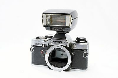 Olympus OM-10 Camera Body and T-20 flash for parts or repair as-is