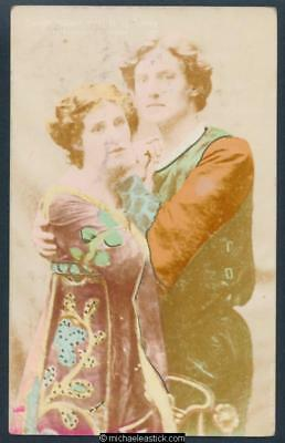 Glamour coloured postcard of Evelyn Millard and Henry Ainley