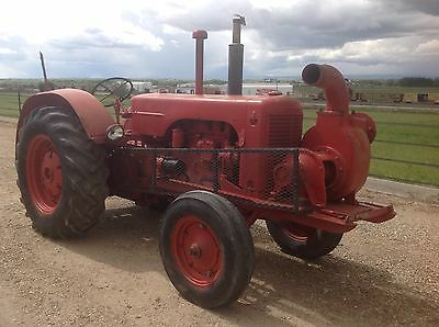 1949 J.I. Case LA Tractor. 6.6L 4-cyl gas engine, 51 hp, 6 inch irrigation pump