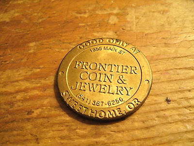 Frontier Coin & Jewelry Sweet Home, Or.- One Dollar Off Token
