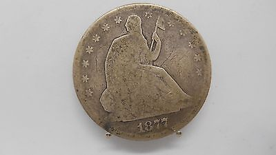 1877 seated liberty half dollar in circulated condition