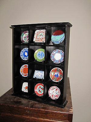 Miniature Japanese porcelain plate collection x 12, on stands in showcase