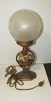 Antique Cast Iron Electric Lamp With Pirate Ship And Glass Round Frosted Shade