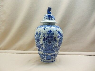 A Delft blue hand painted vase with lid marked Porceleyne Fles yearsign 1974.