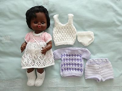 Brown/ Black Plastic Dressed Doll Plus Extra Clothes