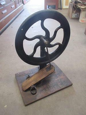 Drive wheel, fly wheel, foot operated, cast steel, antique tool