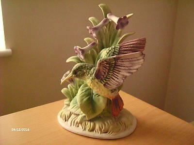 "Vintage Hummingbird Figurine 7"" High."