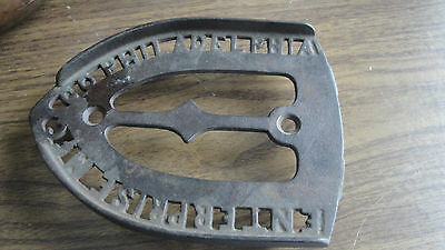 metal  Enterprise MFG Co Sad Iron holder trivet Philadelphia 3 feet & lip