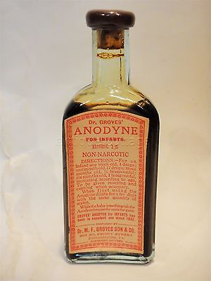 antique DR. GROVES ANODYNE INFANTS embossed BOTTLE/CONTENT quack medicine unused