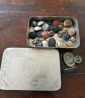 vintage military buttons and badges in 1914 tin