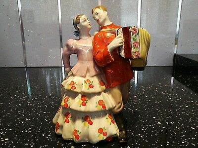 Vintage  Russian Pottery Folk Art Hand Painted Figurine Acordian player and Lady