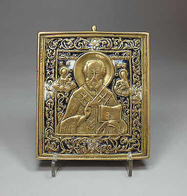 Antique Russian metal travelling icon of St Nicholas of Myra, late 19th century