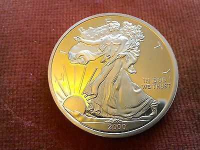 Gold plated American Eagle Liberty coin, reproduction.