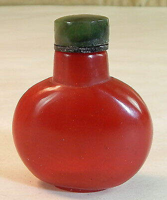 Chinese Red Glass Snuff Bottle with Jade Top, 19th century