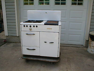 Antique Monarch Gas and Wood stove, in nice condition, rare