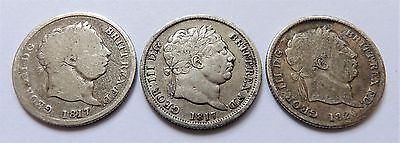 Three George III Sterling Silver Shilling Coins - 1817, 1817 & 1820