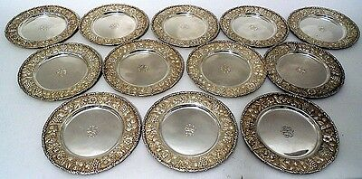 Set of 12 sterling repousse bread plates, Loring Andrews & Co., Cincinnati, Ohio